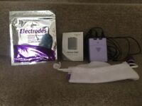 Tens machine and set of new pads