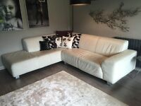 5 seat contemporary ivory corner sofa with aluminium feet. Included is a single matching seat