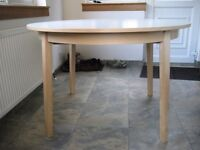 "Dining Table (expandable). Great Condition, Pale Wood Frame, White Top (version of Ikea's ""BJURSTA"")"