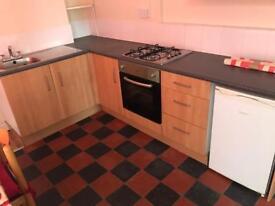 Kitchen. L shaped 168cm x 279cm x 90cm tall.