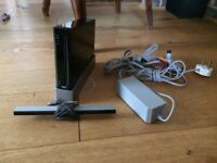 Wii with 3 remotes, balance board, and 6 games