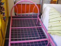CHILD'S SINGLE PINK METAL BED