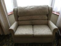 2 seater sofa as shown in the photographs