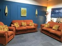 Orange fabric suite 3 seater sofas x 2 and armchair