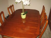 Extendable Dining Table in yew finish with 4 matching chairs very good condition
