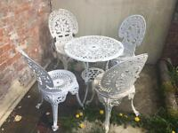 Victorian style white cast metal patio table and chairs