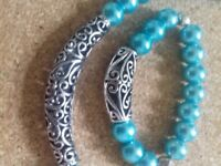 Turquoise pearl set comprising necklace, 3 bracelets and pr earrings. .
