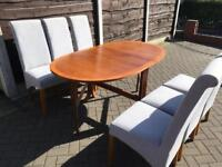 Drop leaf dining table and 6 blue coloured fabric chairs