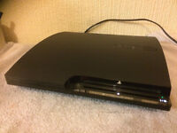 SLIM PS3 CONSOLE - VERY GOOD CONDITION + 29 GAMES AND 2 CONTROLLERS (USED)