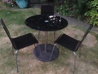 Black glass round table and chairs