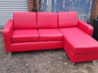 Lovely BRAND NEW red leather small corner sofa.or 3 seater and a footstool.can deliver