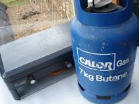 ONE PART FILLED CALOR GAS BOTTLE PLUS ONE EMPTY.
