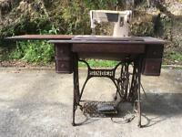 Electric Singer sewing machine in Singer treadle table