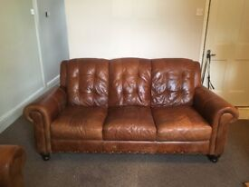 Tan leather 2 and 3 seater sofas.