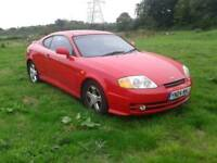 2004 hyundai coupe (only 64k )
