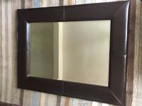 Large brown leather framed mirror