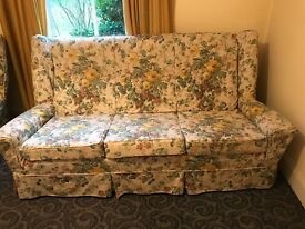 Very old sofa and two chairs, with covers, good condition