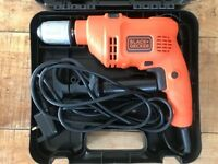 Almost as new electric power drill with hammer action. Black & Decker