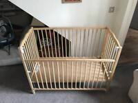 Solid wood cot with adjustable side