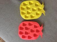 Pink and yellow pineapple ice trays