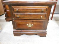 dark wooden oak unit with 2 drawers, and brass furniture. excellent condition. can deliver