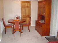 Dining table, 4 matching chairs and glass fronted cabinet