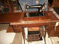 peddle singer sewing machine and cabinet