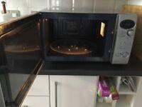 Samsung CK 139S. A silver combination microwave 900 watt oven