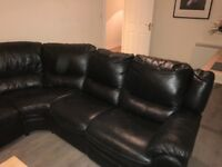 Black leather corner couch with recliners