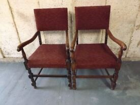Pair of oak framed upholstered elbow carver chairs. good order. £40
