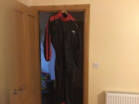 All in one wet suit. Never used, brand new, black and red, Exra Large