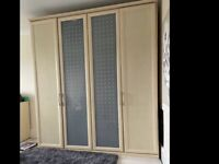 Very large 4 door wardrobe vgc can deliver and assemble too