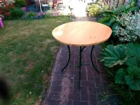 Garden table made of wood and metal