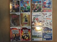 Nintendo wii boxed with 2 controllers and 12 games