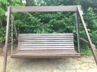 Large Garden swing (wooden) local delivery by arrangement. Seats four.