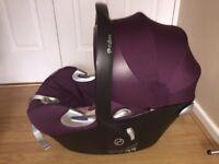 Purple Cybex Aton infant car seat & isofix base