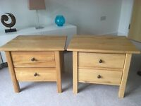 A pair of solid oak 2 drawer chests