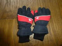 Kids black and red ski gloves age 7-10 good used condition collection only please