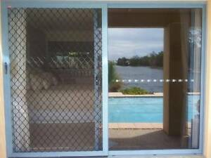 Two Glass sliding doors with security screens and timber reveal. Twin Waters Maroochydore Area Preview