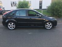 Ford Focus 1.6 in panther black alloy wheels and body kit scratch down the side and on bonnet