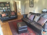 Leather 3 seater and 2 seater sofas plus matching footstool