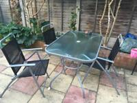 Outdoor glass top table and four chairs