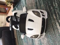 Electric child's ride-on car ( Jaguar) White