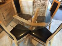 Solid wood and glass top dining table and chairs