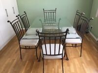 Quality Glass top dinning table & 6 fabric covered chairs