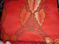 large red patterned bedspread. thick.