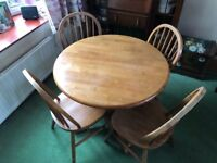 Circular oak table and 4 chairs