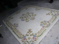 "LARGE INDIAN WOOL RUG. 8' 10"" X 7' 6"". FRINGED WITH BEAUTIFUL PATTERN IN STONE/CREAM COLOUR."