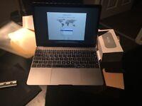 Macbook 12 mint 2015 with software bundle.
