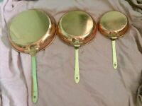 Set of three vintage copper pans